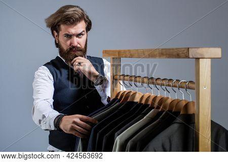 Men Clothing, Boutiques. Tailor, Tailoring. Stylish Mens Suit. Man Suit, Tailor In His Workshop. Han