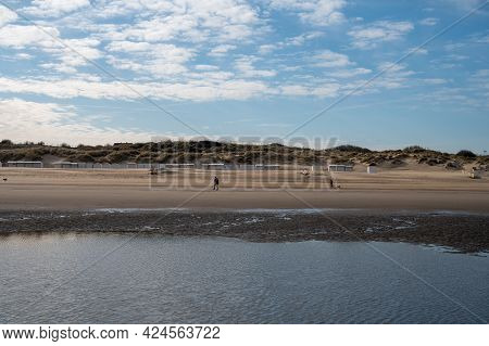 Low Tide Period On Yellow Sandy Beach In Small Belgian Town De Haan Or Le Coq Sur Mer, Luxury Vacati