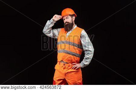 Builder In Hard Hat, Foreman Or Repairman In The Helmet. Bearded Man Worker In Building Helmet Or Ha
