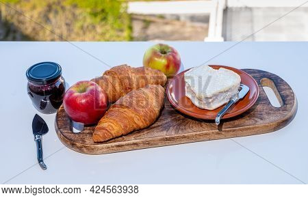 French Breakfast With Fresh Baked Croissants And Cheeses From Normandy, Heart-shaped Neufchatel Serv