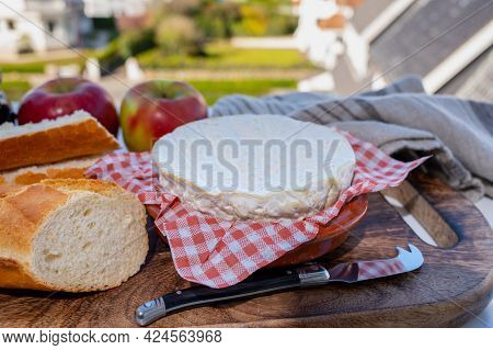 French Breakfast With Fresh Baked Baguette Bread And Camembert Chees From Normandy, Served Outdoor W