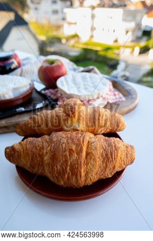 French Breakfast With Fresh Baked Croissants And Cheeses From Normandy, Camembert And Neufchatel Ser