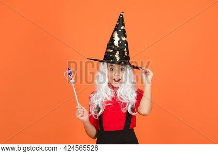 Happy Halloween Witch Girl. Teenage Child In Witch Hat. Cheerful Kid Use Magic Wand. Work Wonders. C