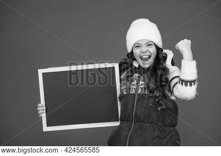 Very Profitable Proposition. Happy Girl Empty Blackboard. Copy Space. Useful Information Here. Winte