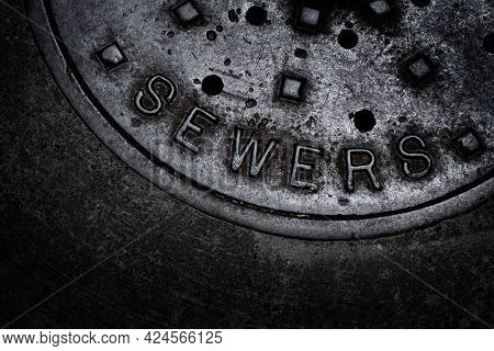 Sewer manhole cover maintenance iron steel access to utility