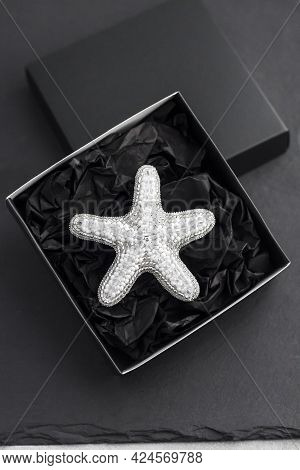 Seed Bead Embroidered Brooch In A Shape Of Starfish In Black Box On Black Background