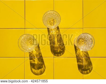 Refreshing Summer Drinks In Crystal Glasses On Yellow Bar Tile Background Harsh Shadow. Sweet Cold N