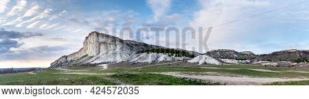 White Cliff Landscape Panorama In Sunset Light For Wallpaper Design. Beautiful Nature Panorama Backg
