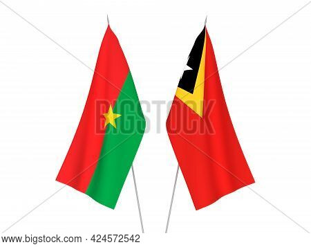 National Fabric Flags Of East Timor And Burkina Faso Isolated On White Background. 3d Rendering Illu