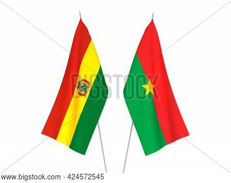 National Fabric Flags Of Bolivia And Burkina Faso Isolated On White Background. 3d Rendering Illustr