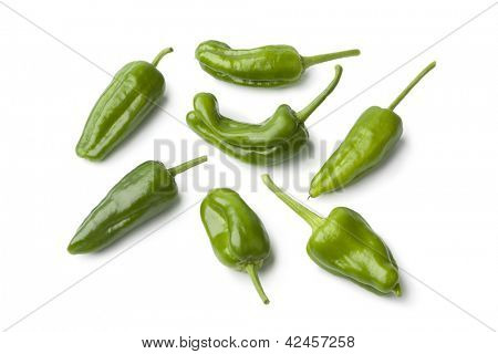Fresh raw green Pimientos de Padron on white background