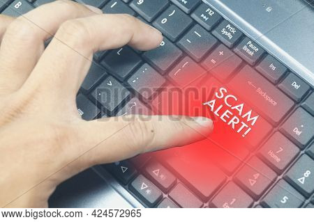 Hand Pressing Keyboard And Word Scam Alert. Selective Focus.