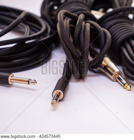 Audio Cables For Musical Instruments And Microphones On A White Background