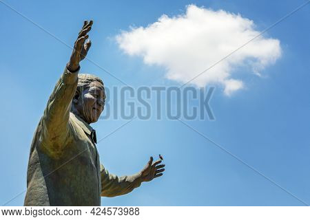 Pretoria, South Africa - 4th November 2016: Giant bronze 9statue of Nelson Mandela, former president of South Africa and  anti-apartheid activist. This stands in the grounds of the Union Building.