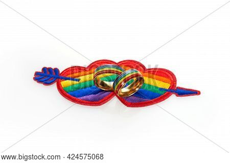 Love Wins Concept With A Multicolored Heart And Wedding Rings. Equality And Love Protection