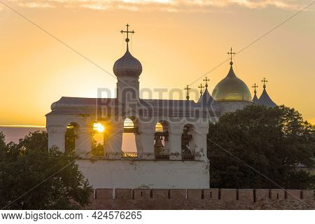 Belfry And Domes Of St. Sophia Cathedral Against The Background Of A June Sunset. Veliky Novgorod, R