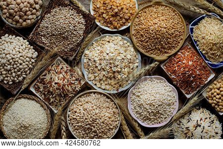 Top View Of Dry Organic Cereal And Grain Seeds In Wooden And Ceramic Bowl On Sack And Grunge Backgro