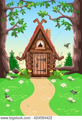 Fairy Tale Hut Made Of Logs With Carved Trim On The Roof, A Chimney And A Horseshoe For Luck. Old Vi
