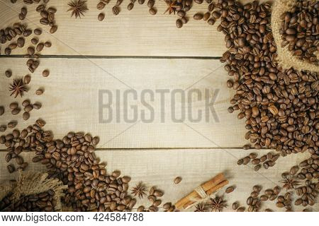 Coffee Beans On A Wooden Background. Hot And Fresh Morning Coffee. Coffee Beans Texture Or Coffee Be