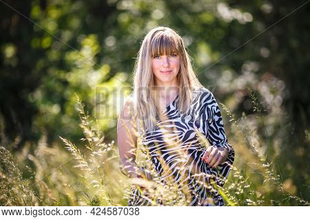 Beautiful Girl Stands In Thicket Of Forest
