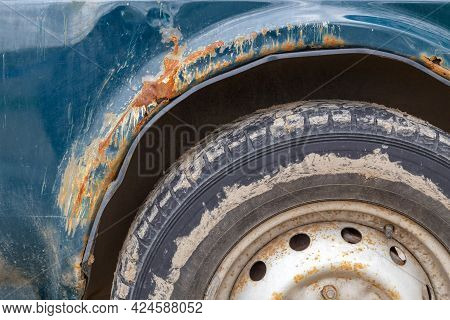 Rusted Off-road Vehicle, Close-up View On Wing And Wheel Arch With Heavy Rust