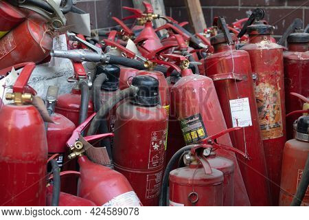 Moscow, Russia-june 4, 2021. Dump Of Old Fire Extinguishers