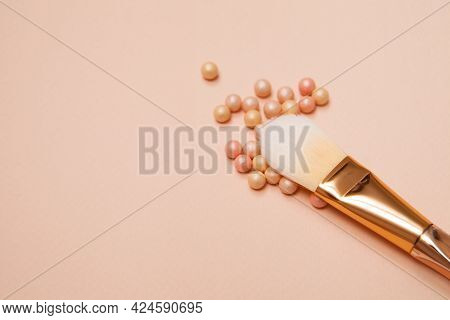 Various Cosmetic Brushes On Pink Background. Makeup Brushes Set For Take Care Skin.