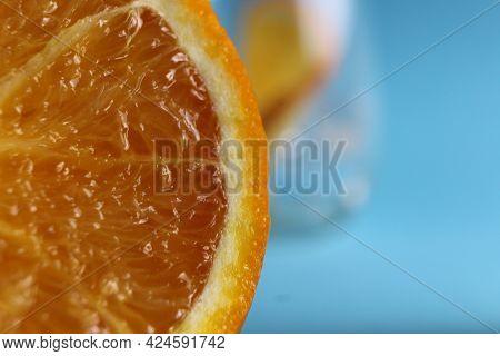 Cut Of The Orange Close-up. Macro Photo Of Eating Orange Fruit. Orange Fruit Background