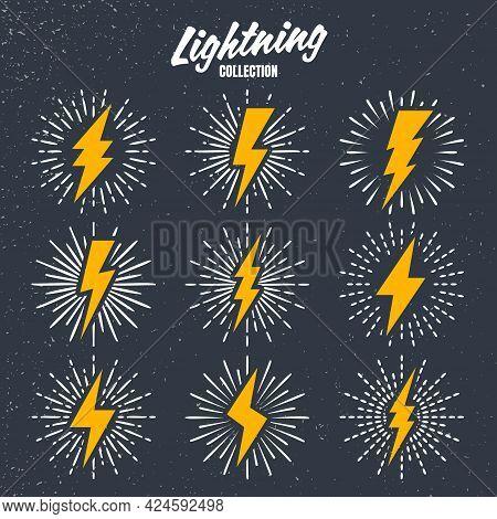 Set Of Yellow Vintage Lightning Bolts And Sunrays On Grunge Background. Lightnings With Sunburst Eff