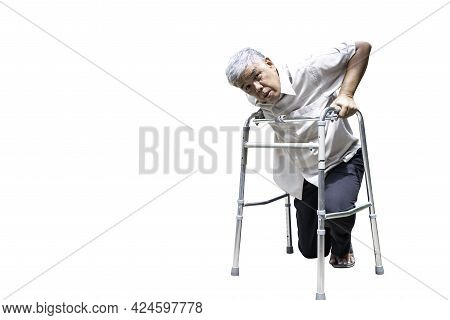An Elderly Asian Man With Osteoarthritis, Trying To Stand With Steel Legs To Help Support To Stand A