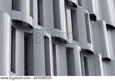 Krasnogorsk, Russia - June 2021: Exterior Of Metal Modern Building. Detail Of Curved Facade In Hi-te