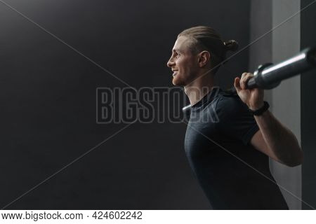 Young Handsome Athlete Doing Exercise With Barbell In Gym. Happy Smiling Man Warming Up And Preparin
