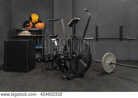 Empty Fitness Gym With Sports Equipment For Workout, Weightlifting, Fitness On The Floor. Training E