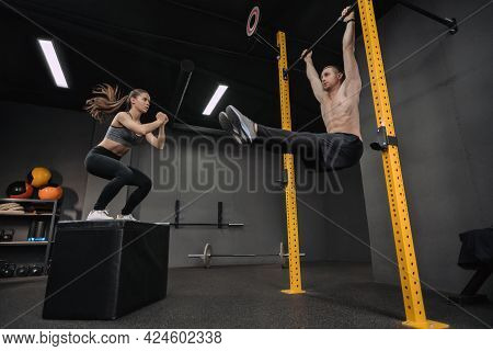 Functional Training Class. Young Couple Doing Exercises At Gym, Having Workout Together. Shirtless M