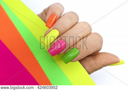 Bright Illuminating Multicolored Fashionable Manicure On A Woman Is Hand.