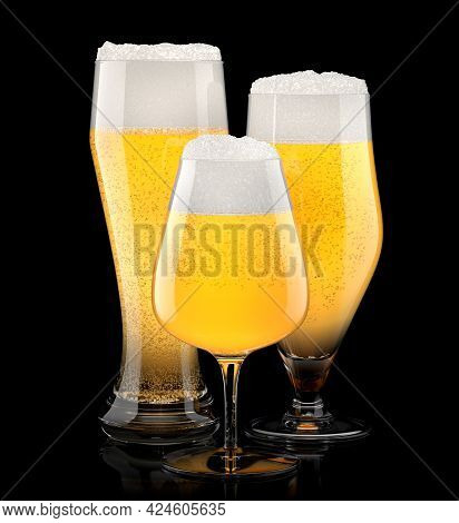 Set Of Fresh Light Beer Glasses With Bubble Froth Isolated On A Black Background. 3d Rendering Conce