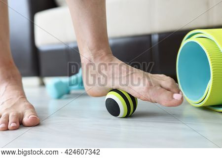 Woman Does Exercises With Ball To Correct Foot Defects And Flat Feet