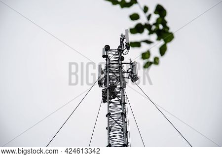 Telecommunication Engineer Working On High Tower,risk Work Of High Work,technician Working With Safe