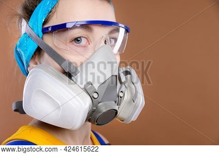 Portrait Of A Young Caucasian Woman In Protective Equipment For The Organs Of Vision And Respiration