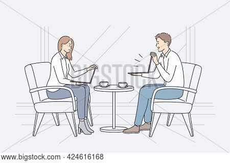 Business Meeting And Discussion Concept. Young Business Partners Woman And Man Sitting With Laptops