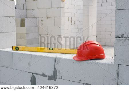 Construction Safety Helmet And Construction Level At The Construction Site. Construction Of A Reside