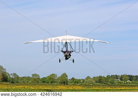 Ultralight Airplane Taking Off From A Grass Strip