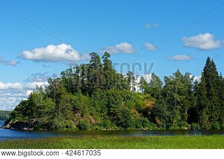 White Turrets Of The Chapel In Ludwigsburg Park Mon Repos In Vyborg On The Background Of Blue Sky.