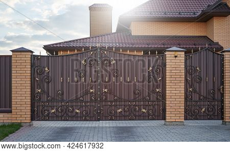Forged Metal Gates With Ornate Lines In A Private House