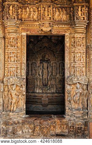 Inner view of Javari temple Hindu temple dedicated to Vishnu with broken and headless Vishnu statue inside, Khajuraho, India