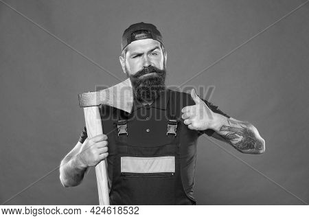 Brutality And Masculinity. Bearded Lumberjack. Man Builder Uniform Hold Axe. Danger Concept. Bearded