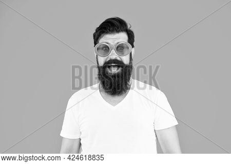 Perfect Glasses For Perfect Party. Party Man Orange Background. Bearded Man Wear Party Sunglasses. F