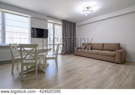 Dining or living room with white round dining table at the middle and sofa