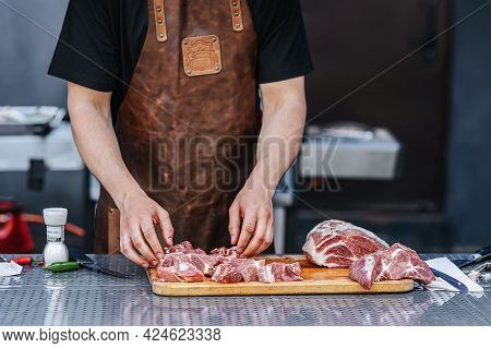 Butcher, Cook Cutting Beef For Barbeque Grill, Piece Of Raw Beef Meat Close-up. Preparation Of Meat,