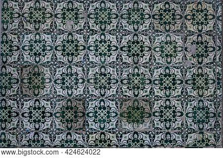 Traditional old tiles wall on the street painted tin-glazed, azulejos ceramic tilework. Porto, Portugal.